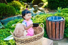 baby playing candy crush natural pose wiht props